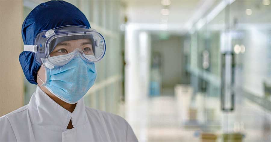 A doctor in a behavioral health facility wears a mask to help improve patient safety