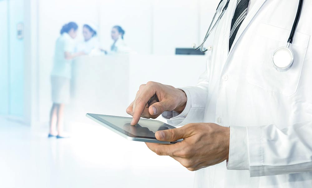 Healthcare Doctor looking at his analytics